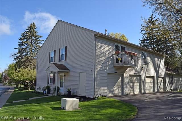 2120 Park Place Drive, Walled Lake, MI 48390 (#2210042526) :: Novak & Associates