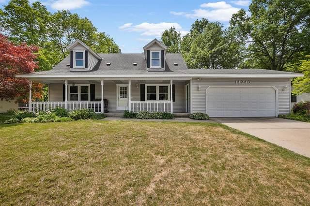 14246 Sunview Drive, Holland Twp, MI 49424 (#65021021764) :: Duneske Real Estate Advisors