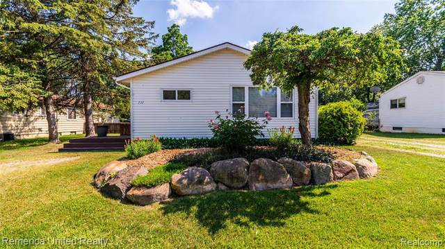717 Lucille Drive, Wolverine Lake Vlg, MI 48390 (#2210045547) :: The Mulvihill Group