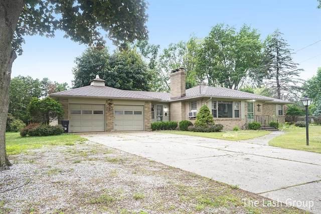 911 Brownwood Avenue NW, Grand Rapids, MI 49504 (#65021023746) :: GK Real Estate Team