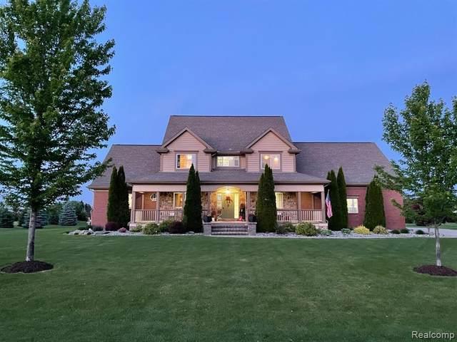 4242 Taggett Lake Drive, Highland Twp, MI 48357 (#2210059835) :: BestMichiganHouses.com