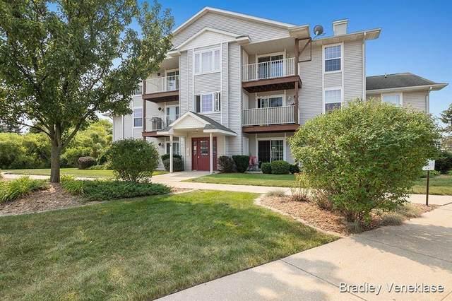 126 Ida Red Avenue NW #303, Sparta Twp, MI 49345 (#65021099052) :: Novak & Associates