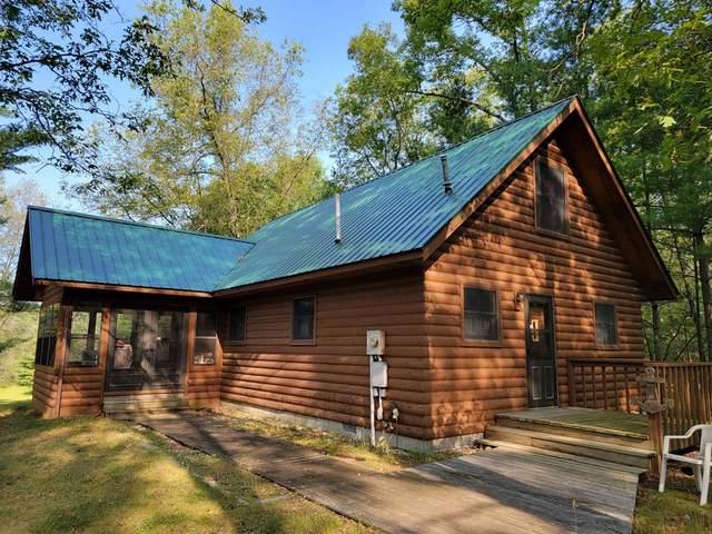 9405 N Bass Lake Road, Elk Twp, MI 49644 (#67021102214) :: The Vance Group | Keller Williams Domain
