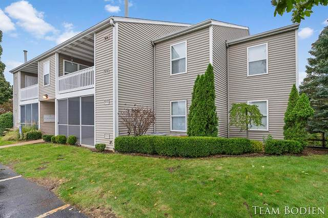 3025 Poplar Creek Drive SE #104, Kentwood Twp, MI 49512 (#65021111995) :: Real Estate For A CAUSE