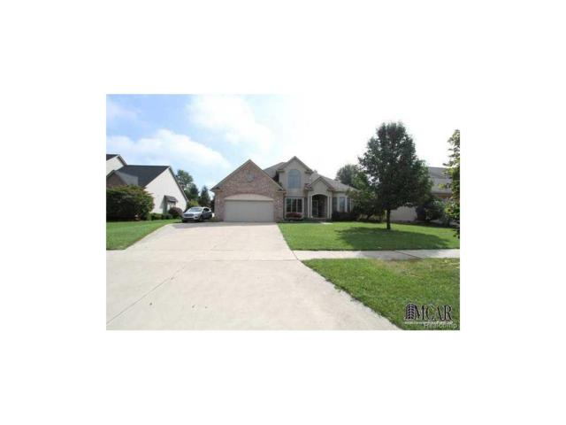 880 Saint Anne Lane, Monroe, MI 48162 (#57003450934) :: The Mulvihill Group