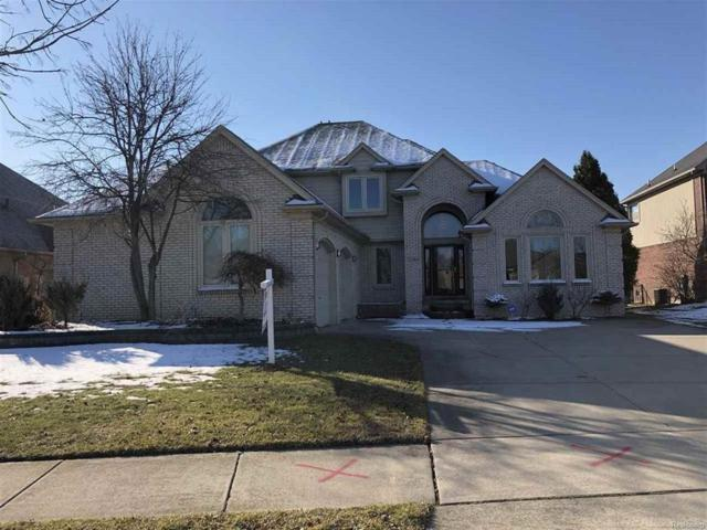 23184 Hidden Creek, Macomb Twp, MI 48042 (#58031341127) :: Simon Thomas Homes
