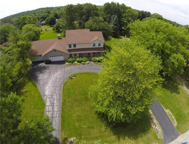 474 Milford Meadows Drive, Milford Twp, MI 48381 (#218056103) :: The Mulvihill Group