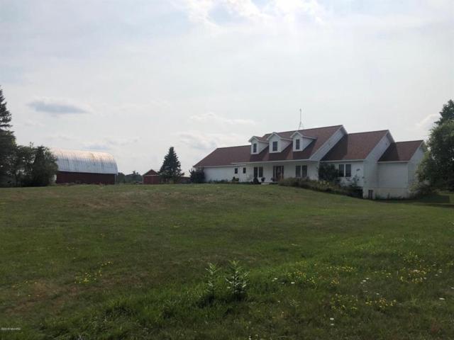 1439 N Bringold Ave, Greenwood Twp, MI 48625 (#53018042583) :: The Alex Nugent Team | Real Estate One