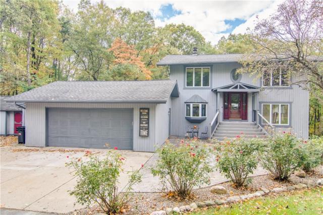 2060 Woodsman Drive, Groveland Twp, MI 48462 (#218102129) :: Duneske Real Estate Advisors