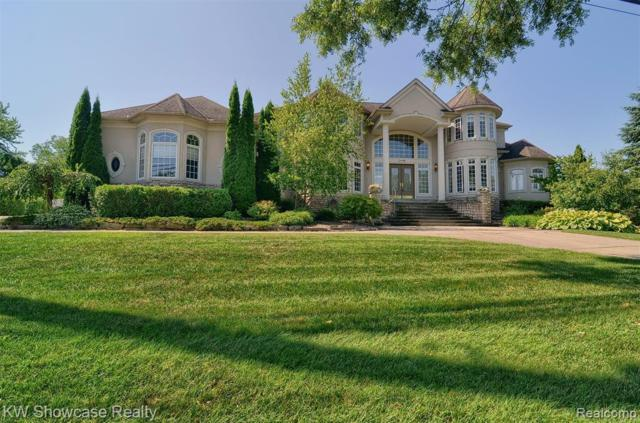 3439 E Commerce Road, Commerce Twp, MI 48382 (#219050844) :: The Mulvihill Group