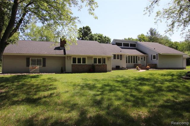 3990 Old Homestead Drive, Howell, MI 48855 (#219054963) :: The Mulvihill Group