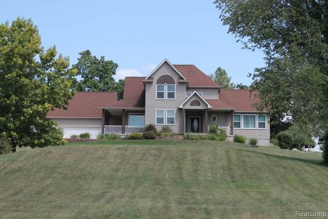 7436 Mabley Hill Road, Tyrone Twp, MI 48430 (MLS #2200058962) :: The John Wentworth Group