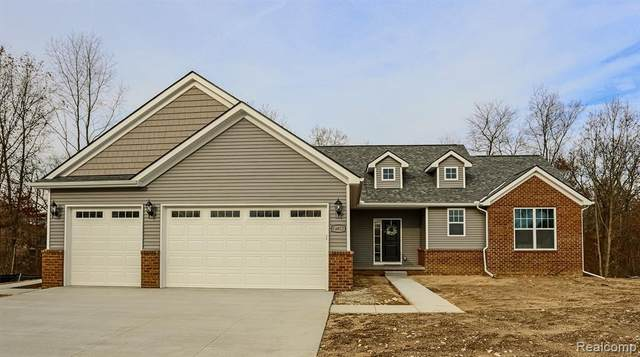 1803 Percy Lane, Highland Twp, MI 48357 (#2210004177) :: The Merrie Johnson Team