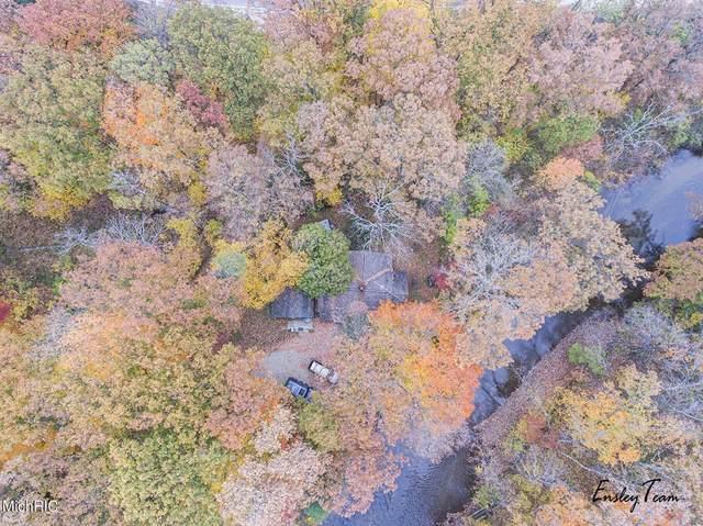 9588 New River Drive, Croton Twp, MI 49329 (#65021004960) :: The Merrie Johnson Team