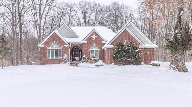 7100 Winters Court, Webster Twp, MI 48130 (#543278966) :: The Merrie Johnson Team