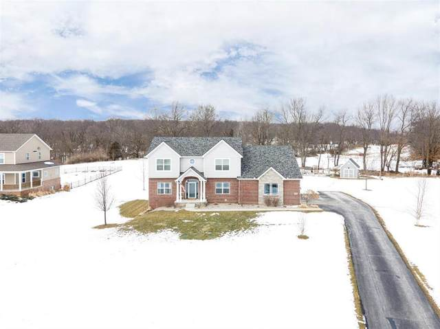 7676 Fox Trace Road, Webster Twp, MI 48130 (#543279034) :: The Merrie Johnson Team