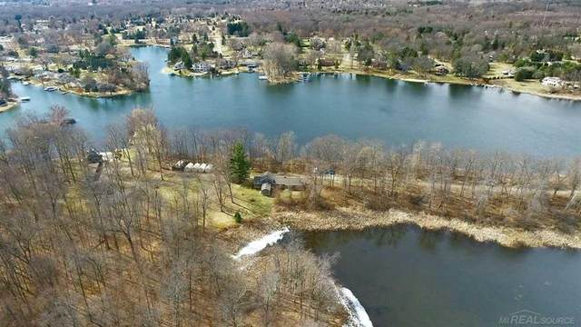 4990 Pepper Trl, Highland Twp, MI 48356 (#58050035144) :: Real Estate For A CAUSE