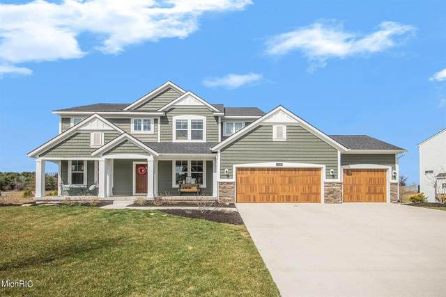 12047 Harvest Home Drive SE, Vergennes Twp, MI 49331 (MLS #65021006949) :: The John Wentworth Group
