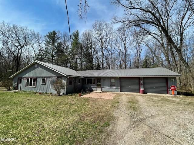 6773 N Bass Lake Road, Elk Twp, MI 49644 (#67021011105) :: The Alex Nugent Team | Real Estate One