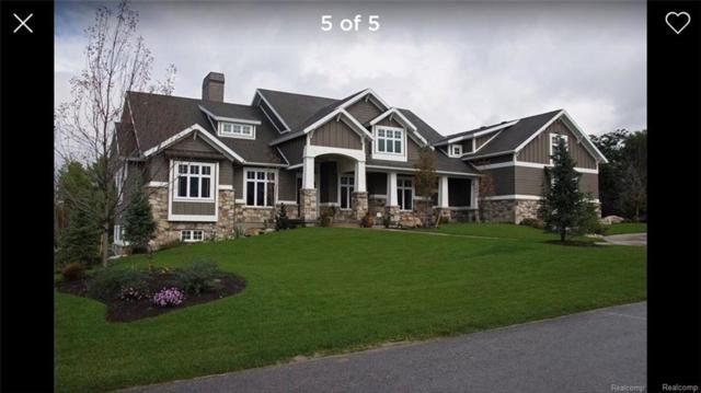 2041 Pine Bluffs Ct, Highland Twp, MI 48357 (#215127974) :: RE/MAX Classic
