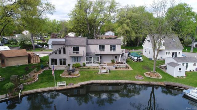 3321 S Woodland Drive, Highland Twp, MI 48356 (#218043833) :: RE/MAX Classic