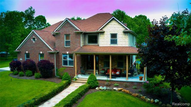 4594 Timberlake Trail, Highland Twp, MI 48357 (#219050465) :: The Alex Nugent Team | Real Estate One