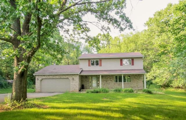 6045 Queen Oaks Drive, Sylvan, MI 48118 (MLS #543266660) :: The Toth Team