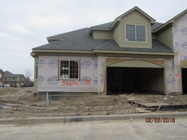 53204 Celtic Drive, Shelby Twp, MI 48315 (MLS #218014275) :: The Toth Team