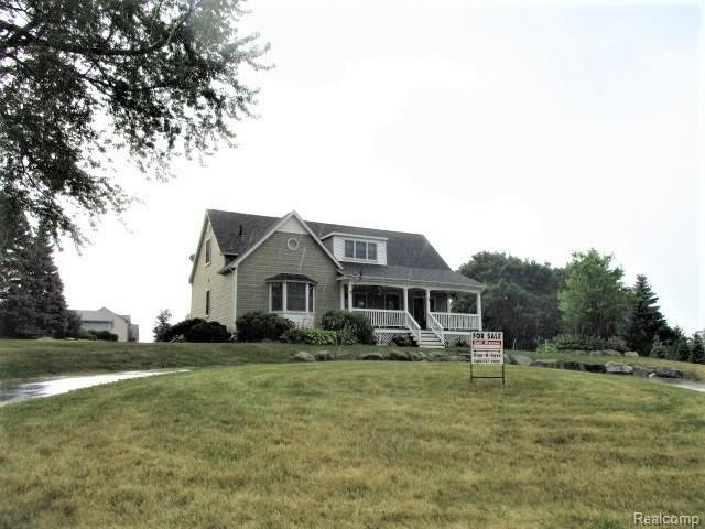 82 Granada Drive, White Lake Twp, MI 48386 (#218066343) :: The Mulvihill Group