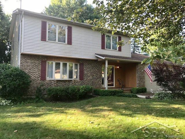 1245 River Forest Dr., Saginaw Twp, MI 48638 (MLS #61031354826) :: The Toth Team