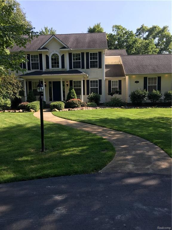 8209 Foster Road, Springfield Twp, MI 48346 (#218085234) :: Duneske Real Estate Advisors