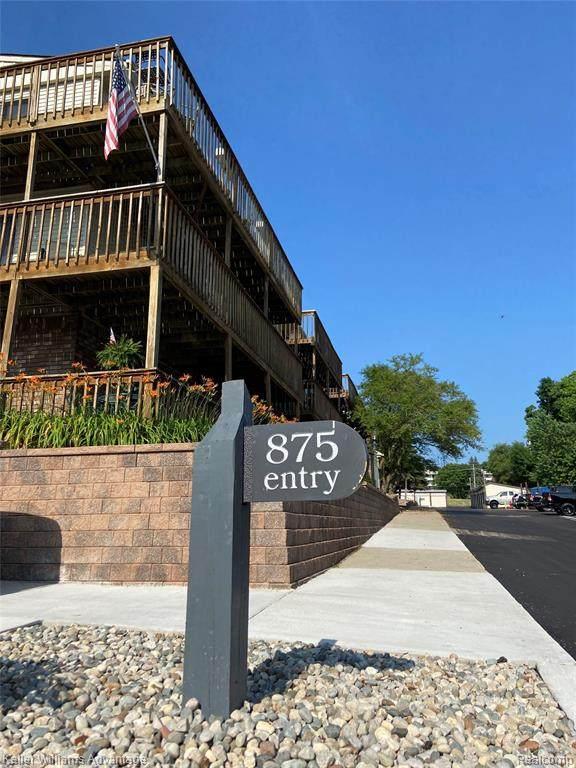 875 S Pontiac Trail B208, Walled Lake, MI 48390 (#2200050678) :: Novak & Associates