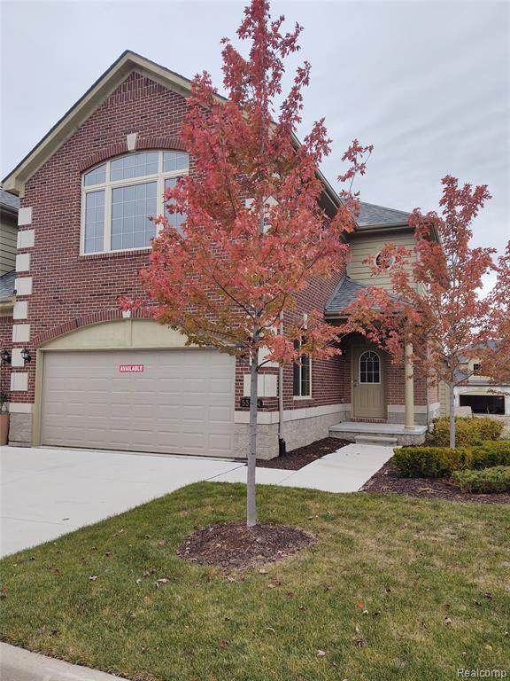 53204 Celtic Drive, Shelby Twp, MI 48315 (MLS #2200087930) :: The John Wentworth Group