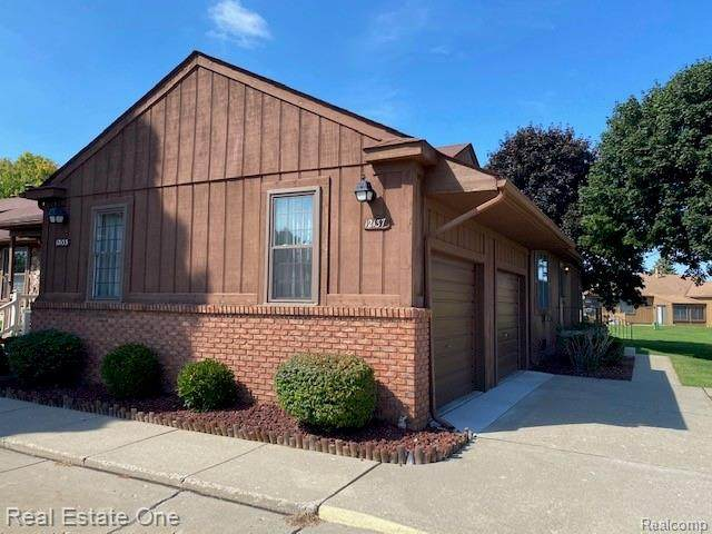 12137 Lexington Drive #4, Green Oak Twp, MI 48178 (#2200092029) :: RE/MAX Nexus