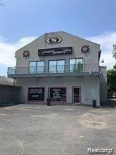 125 Pearl Street, Pinckney Vlg, MI 48169 (MLS #2210005071) :: The Toth Team