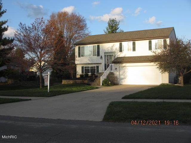 7588 Sunview Drive SE, Gaines Twp, MI 49548 (MLS #65021011865) :: The John Wentworth Group