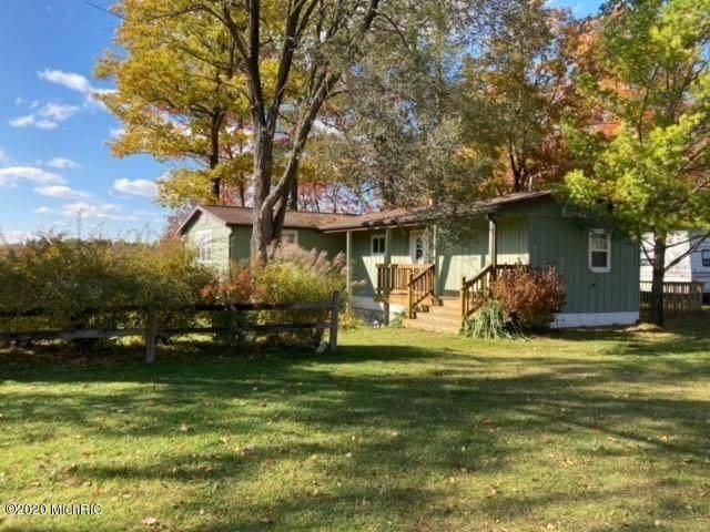 7117 N Canyon Drive, Elk Twp, MI 49644 (#67021106194) :: The Vance Group | Keller Williams Domain