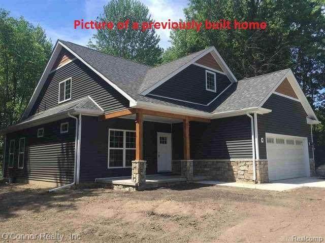 100 Capitol, Marysville, MI 48040 (#2210078505) :: The Alex Nugent Team   Real Estate One