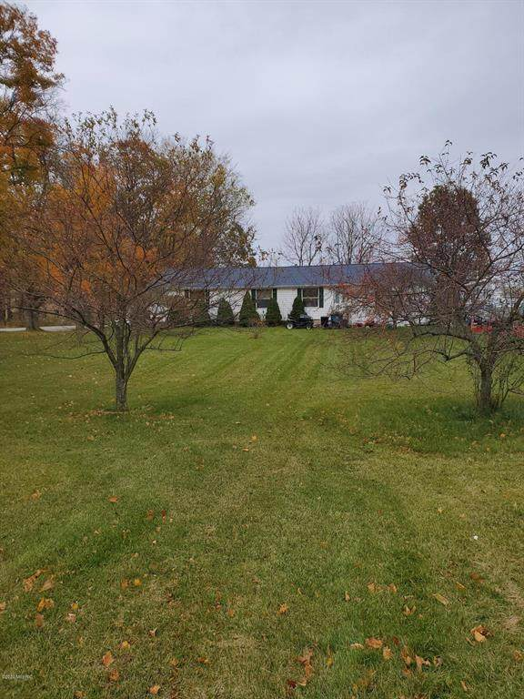 6013 Tanglewood Drive, Boston Twp, MI 49331 (#65021107289) :: Real Estate For A CAUSE