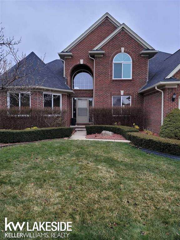 47989 Sandy Ridge, Macomb Twp, MI 48044 (MLS #58050032409) :: The John Wentworth Group