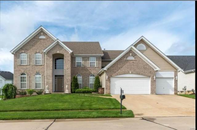 1210 Hermans Lake Drive, Florissant, MO 63034 (#20055255) :: The Becky O'Neill Power Home Selling Team