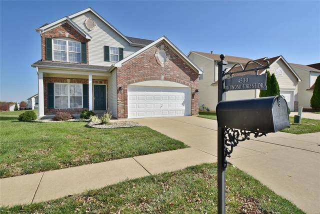 4530 Richmond Forest Drive, Florissant, MO 63034 (#20067385) :: The Becky O'Neill Power Home Selling Team