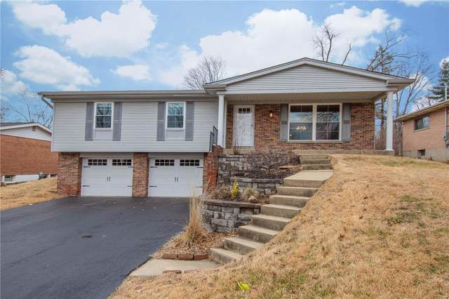 9143 Fort Donelson, St Louis, MO 63123 (#21006551) :: Parson Realty Group