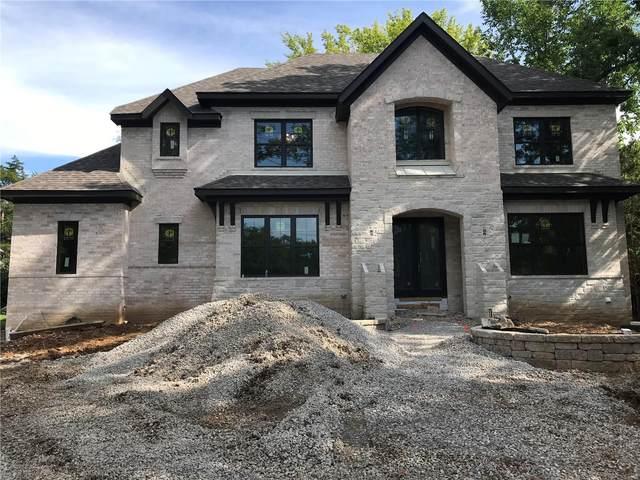 7465 Clayton Road, Clayton, MO 63105 (#21008861) :: Jenna Davis Homes LLC