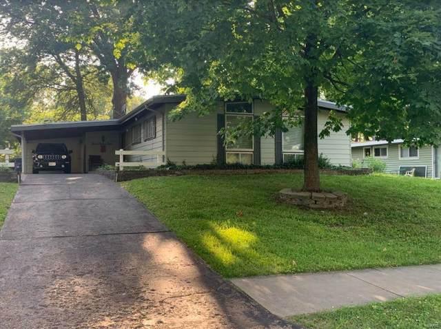 385 Holiday Hill Drive, Florissant, MO 63033 (#21040673) :: Hartmann Realtors Inc.