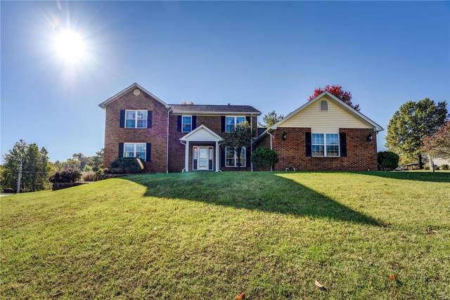 5201 Roanoke Drive, Weldon Spring, MO 63304 (#20071339) :: Parson Realty Group