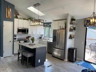 3861 Justice, Florissant, MO 63034 (#21042028) :: Kelly Hager Group   TdD Premier Real Estate