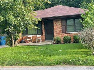 7000 Winchester Drive, Northwoods, MO 63121 (#21051007) :: Parson Realty Group
