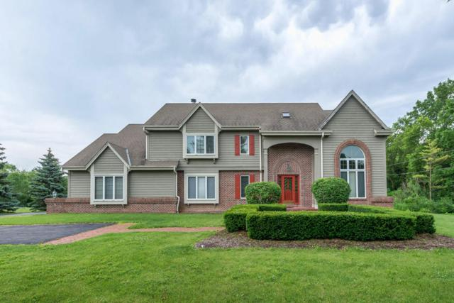 11906 N Solar Ave, Mequon, WI 53097 (#1536929) :: Tom Didier Real Estate Team