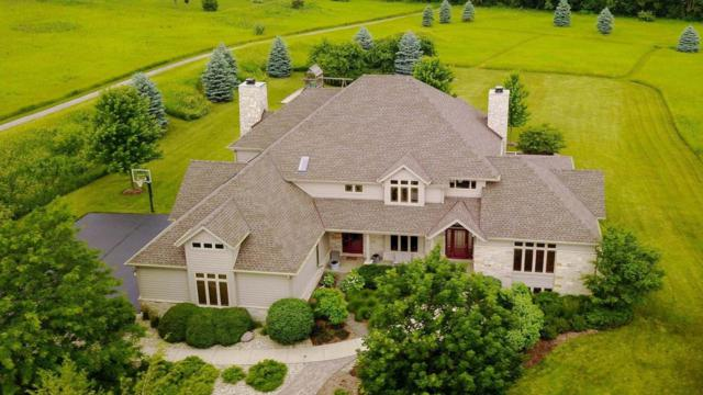 7244 W Ridgeview Ct, Mequon, WI 53092 (#1537129) :: Tom Didier Real Estate Team
